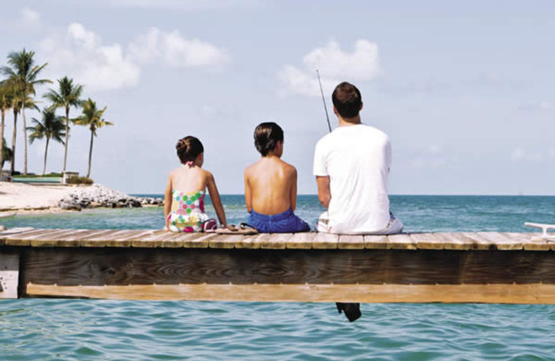 Family on dock at Sunset Key Guest Cottages, a Luxury Collection Resort.