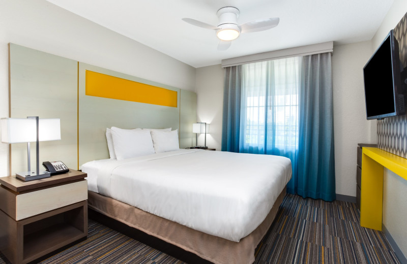 Guest bedroom at Holiday Inn Resort Orlando Suites - Waterpark.