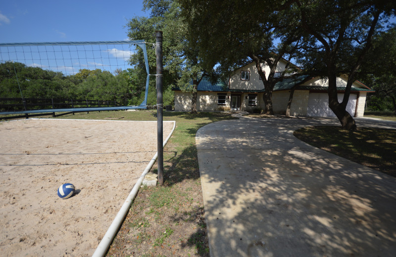 Rental volleyball court at Frio Family Getaway