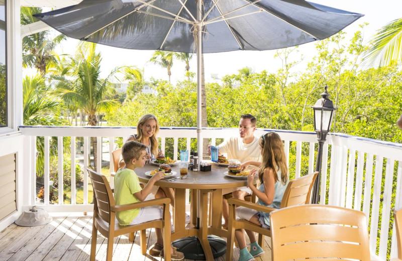 Family on balcony at Palm Island Resort.