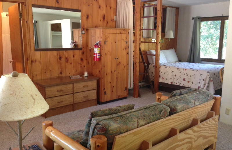 Cabin living room at Thomsonite Beach Inn & Suites.