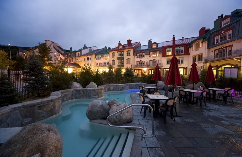 Outdoor pool at Homewood Suites by Hilton Mont-Tremblant Resort.