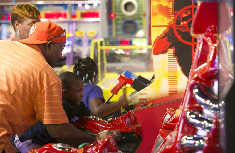 Family playing at arcade at Massanutten Resort.