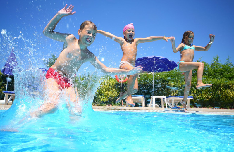 Kids jumping in pool at Lakeway Resort and Spa.