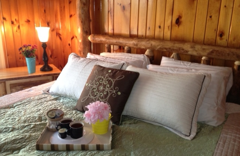 Cabin bed at Timber Wolf Lodge Cabins.