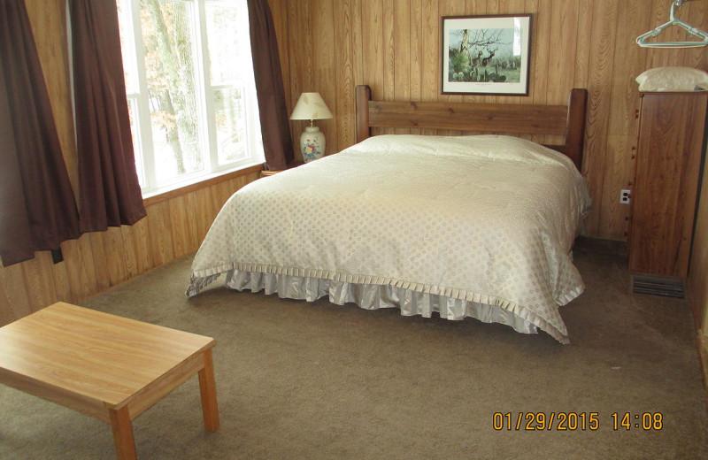 Cabin bedroom at Mallard Lake Family Resort.