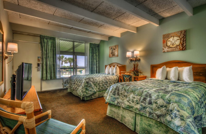 Guest room at Days Inn & Suites Jekyll Island.