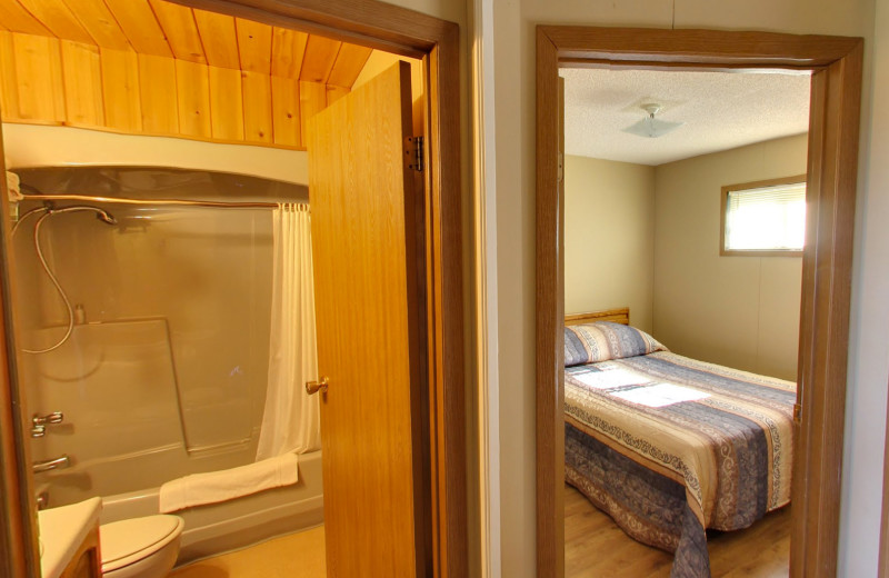 Cabin bath and bedroom at Buffalo Point Resort.