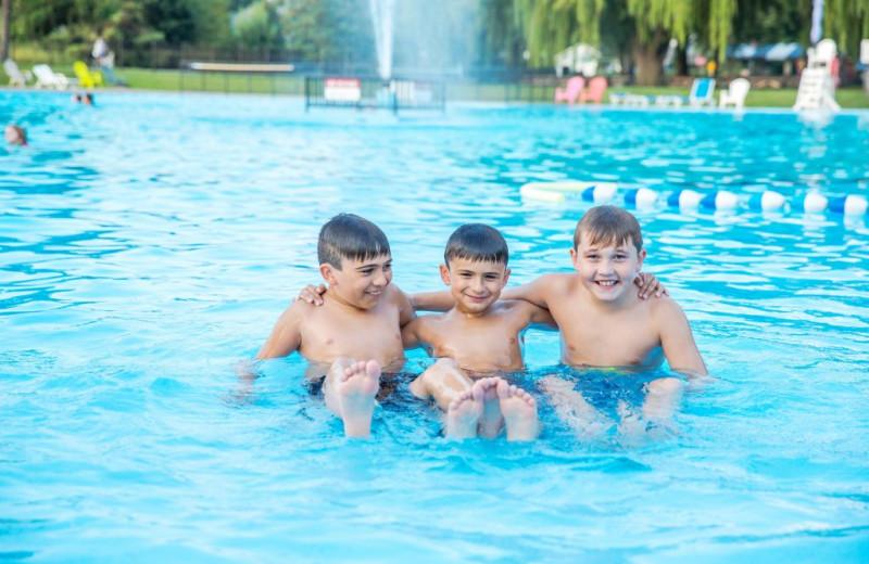 Kids in pool at Great Blue Resorts- Vine Ridge Resort.
