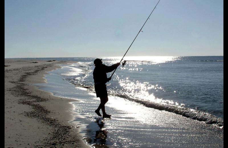 Fishing on beach at Seafarer Condominiums.