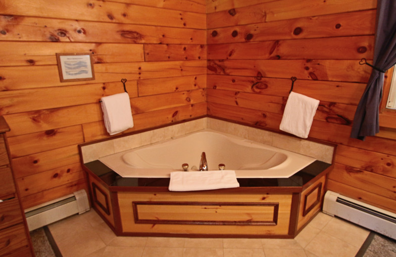 Cabin hot tub at The New England Inn & Lodge.