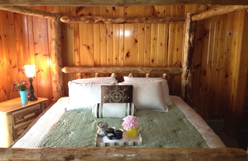 Cabin bedroom at Timber Wolf Lodge Cabins.
