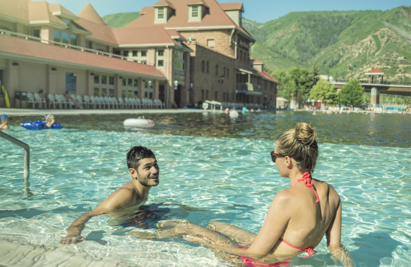 Couple by the pool at Glenwood Hot Springs Resort.