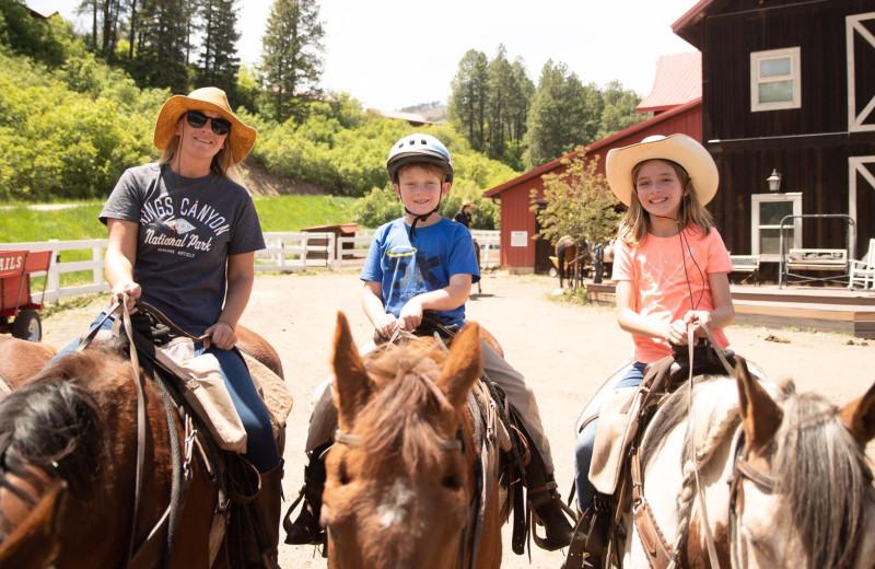 Family horseback riding at Colorado Trails Ranch.