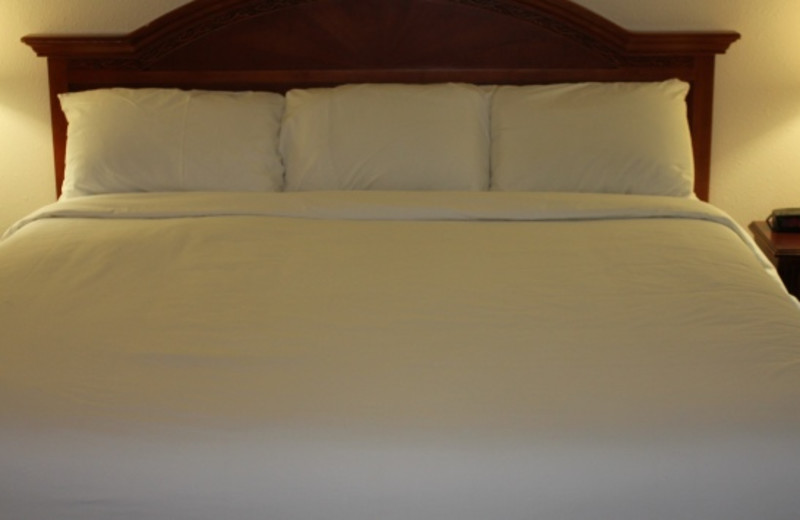 Guest bed at GuestHouse Inn & Suites Aberdeen.