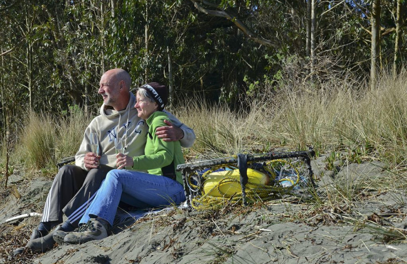 Couple on beach at Redwood Coast Vacation Rentals.