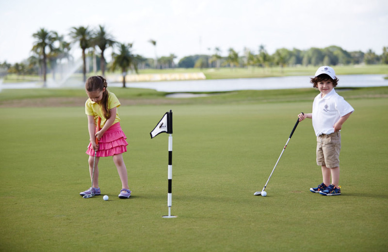 Kids playing golf at Trump National Doral Miami.