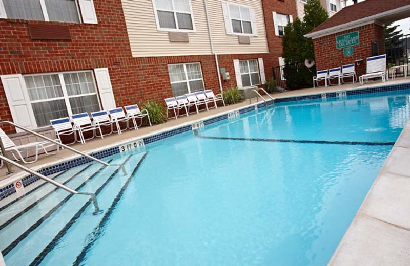 Outdoor pool at TownePlace Suites Detroit Livonia.