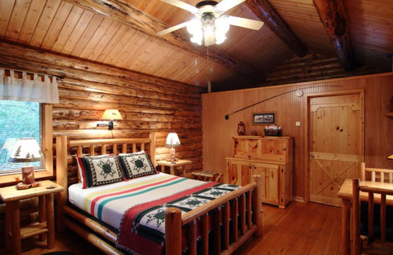 Cabin bedroom at Silverwolf Log Chalet Resort.