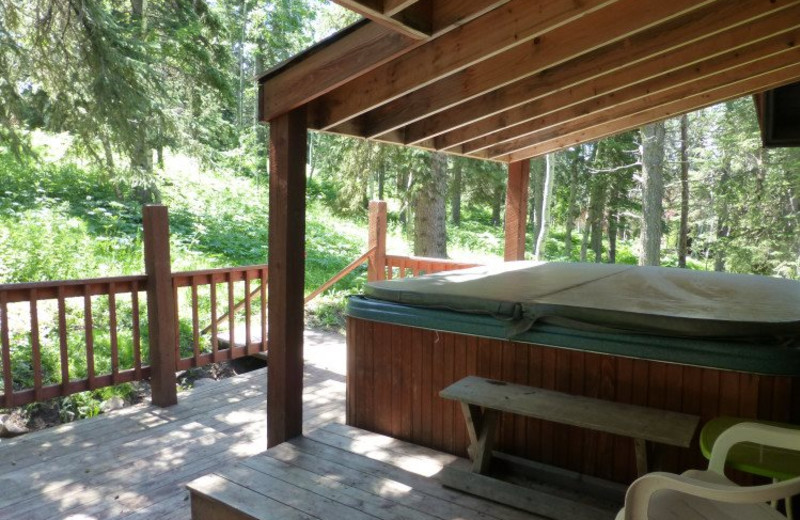 Cabin deck with jacuzzi at Deadwood Connections.