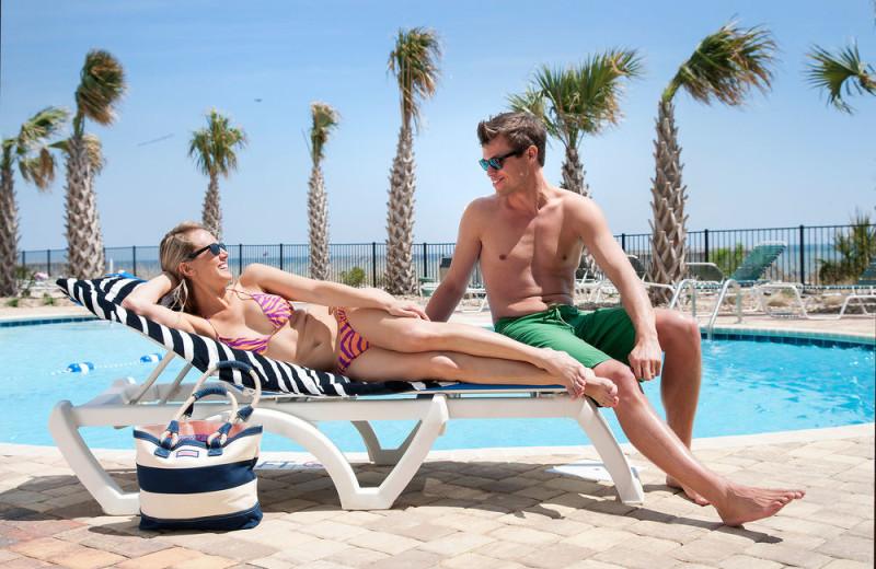 Couple at pool at The Palace Resort.