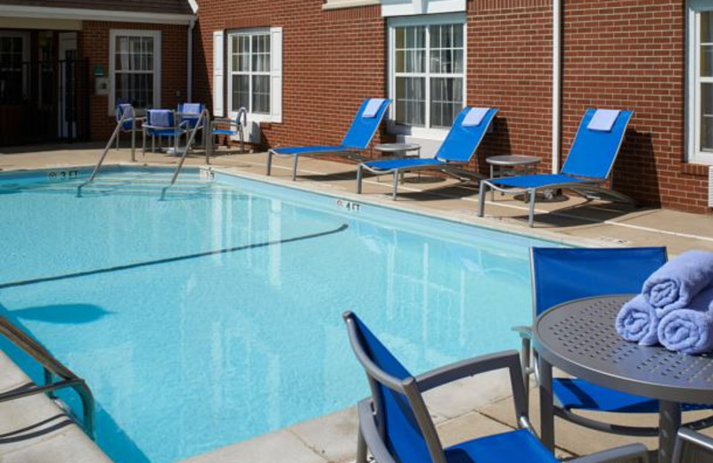 Outdoor pool at TownePlace Suites by Marriott Detroit Novi.