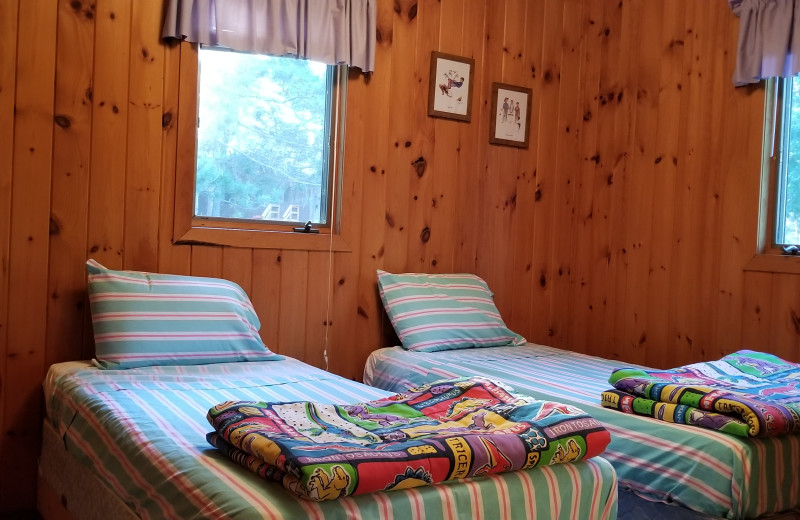 Cabin bedroom at Evergreen Bay Resort.