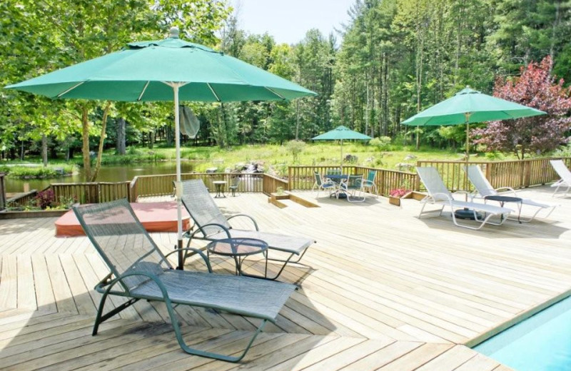 Relax by the Pool at Enchanted Manor of Woodstock