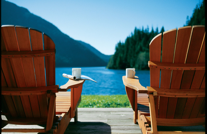 Lounge chairs by lake at Clayoquot Wilderness Resort.