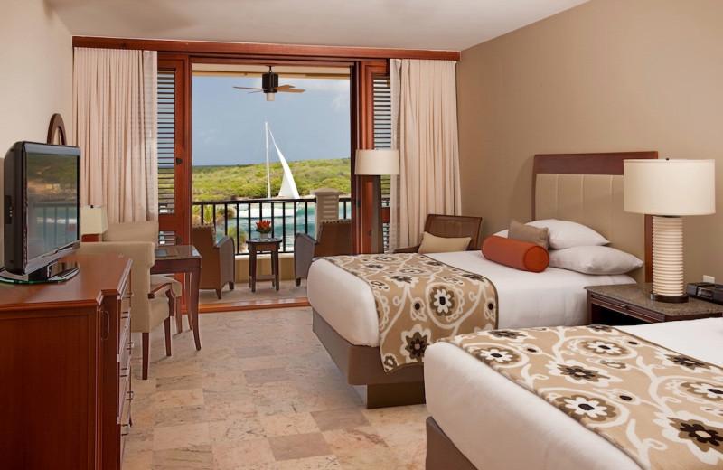 Guest room at Hyatt Regency Curacao Golf Resort, Spa and Marina.