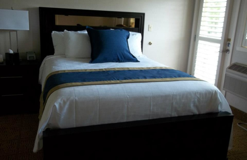 Guest bed at Fairway Suites.