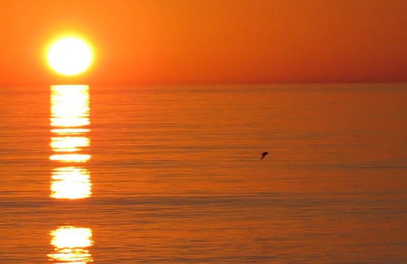 Beach sunset at Sunrise Bay Resort & Club Condominium.