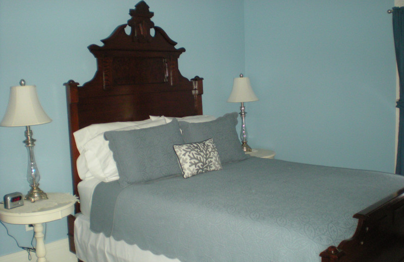 The Seneca Room offers a Queen bed, sitting area and beautiful views of the gardens and Seneca Lake.