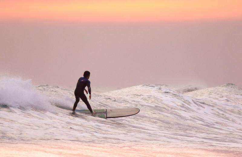 Surfing at Hawaiian Vacation Rentals.
