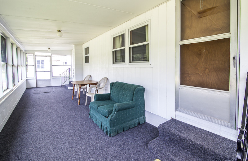 Cottage porch at Riverbank Motel & Cabins.