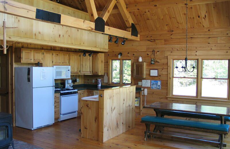 Rental kitchen at Franconia Notch Vacations Rental & Realty.