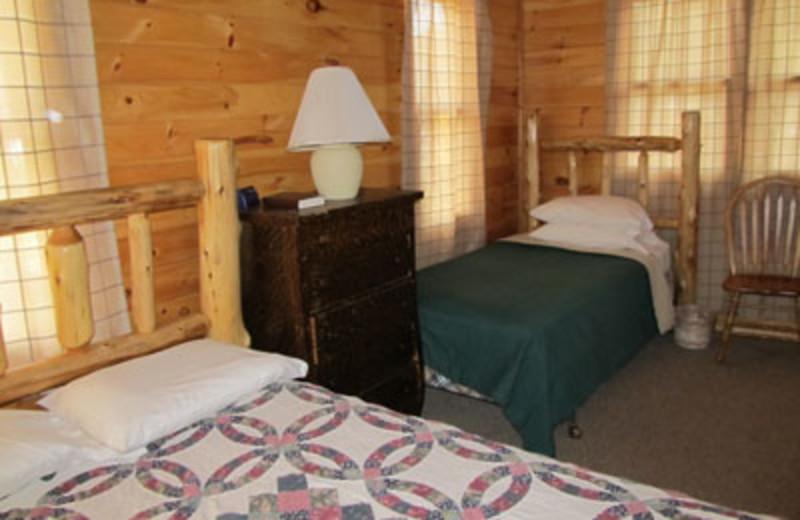 Cabin guest room at Lac La Belle Lodge.