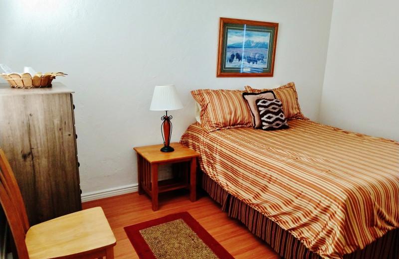 Cabin bedroom at East Glacier Motel & Cabins.
