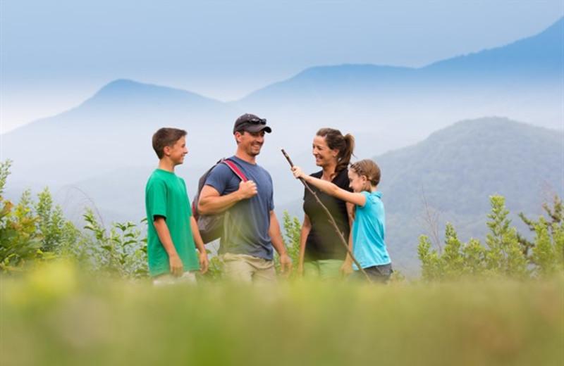 Family hiking at Mountain Shadows Resort.