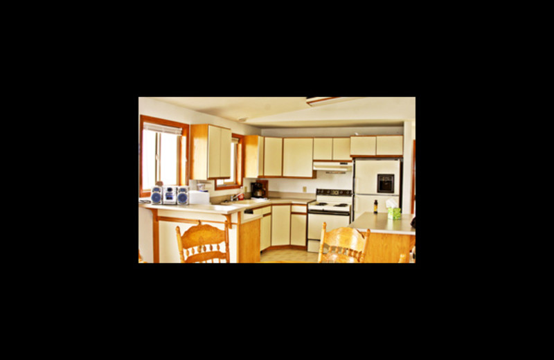 Guest kitchen view at Ocean Shores Ocean View Homes.