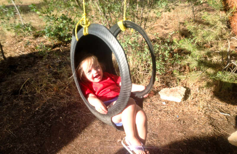 Child on tire swing at Zion Ponderosa Ranch.