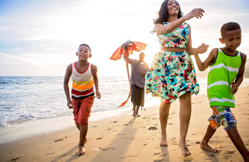 Family on beach at Walker Vacation Rentals.