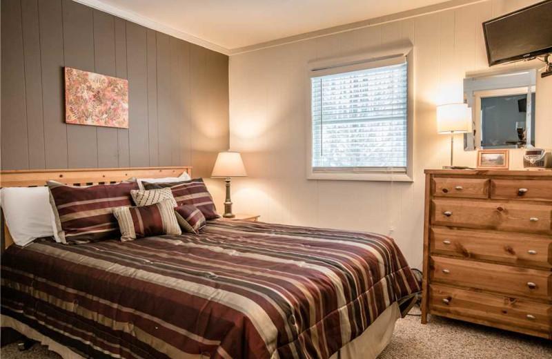 Cabin bedroom at Big Powderhorn Lodging Association.