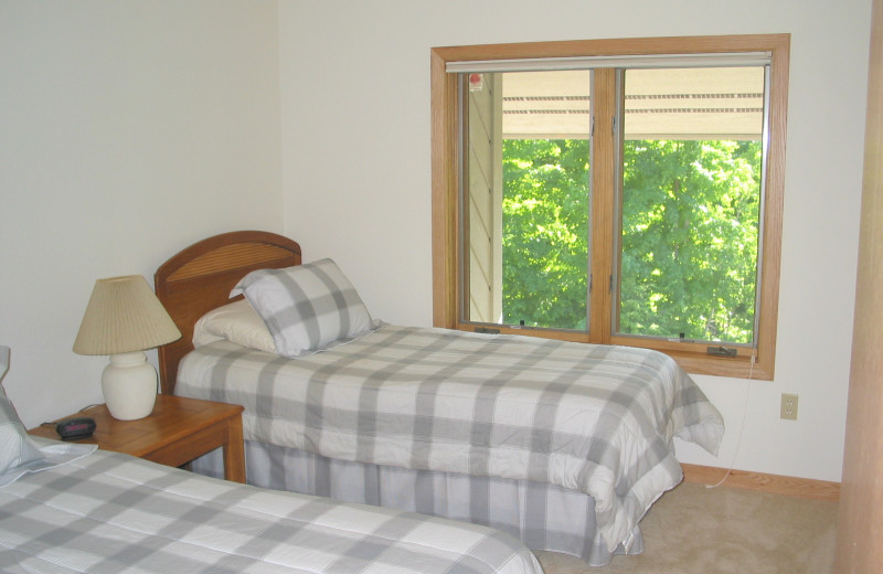Rental bedroom at Hamlet Village Resort Condominiums.