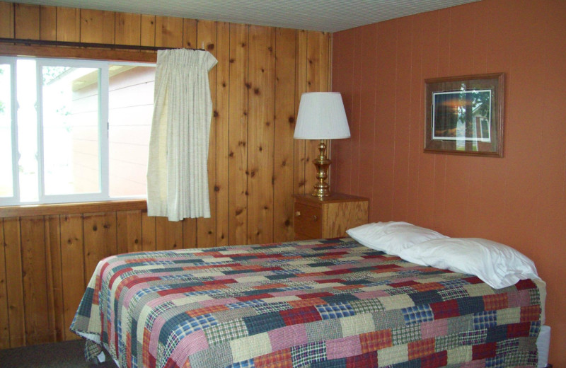 Cabin bedroom at Ottertail Beach Resort.