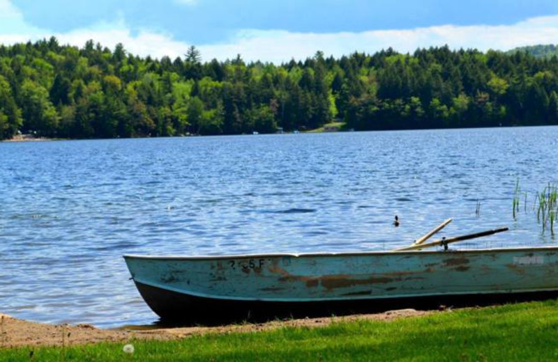 Lake with boat at Twin Pines Resort.
