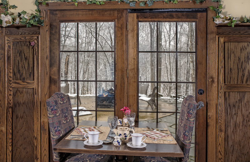 The St. Andrews dining room with view to the woods at Glenlaurel, A Scottish Inn & Cottages.