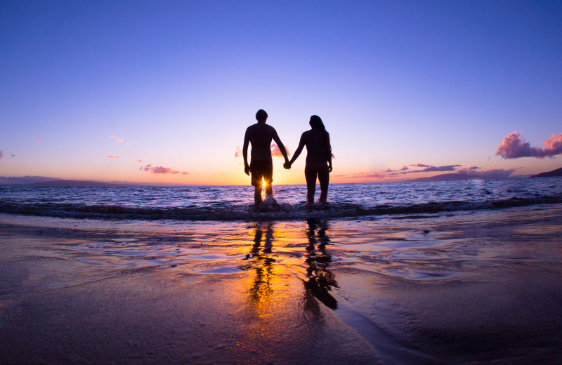 Couple on beach at Jersey Cape Realty.