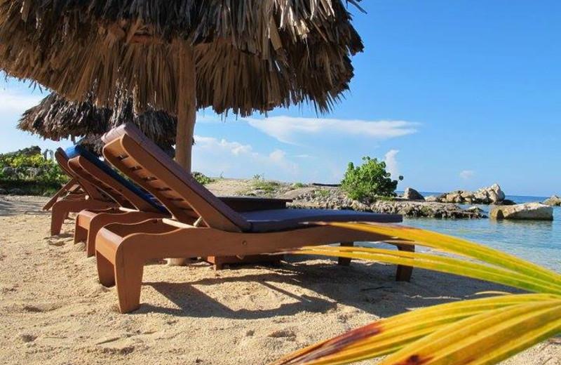 Beach at Coral Cove Resort.