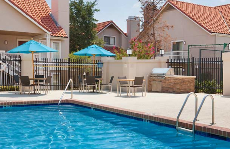 Outdoor pool at Residence Inn by Marriott Dallas - Las Colinas.